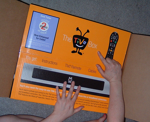 "Christine unpacking our new Tivo, ""Snape""!"