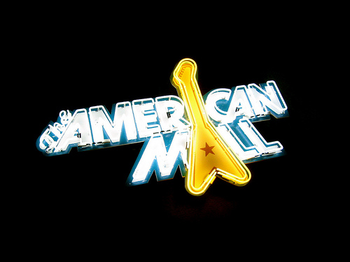 """The American Mall"" neon sign over the bar"